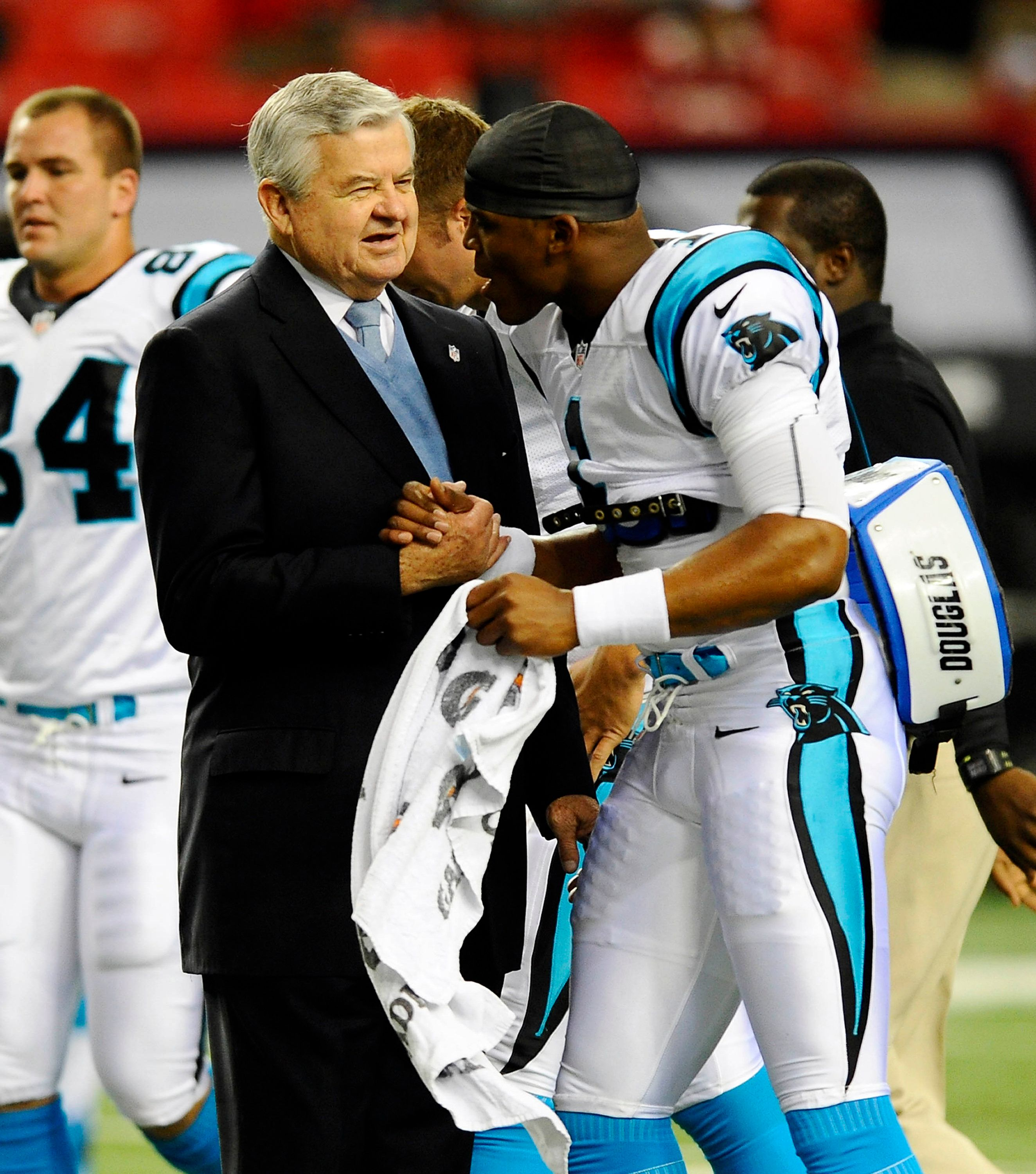 Carolina Panthers owner Jerry Richardson greets quarterback Cam Newton prior to Carolina's game against the Atlanta Falcons a