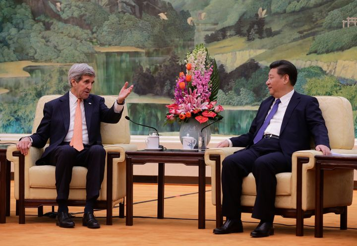 Kerry, pictured here with Chinese President Xi Jinping, also stressed the need to ease South China Sea tensions.