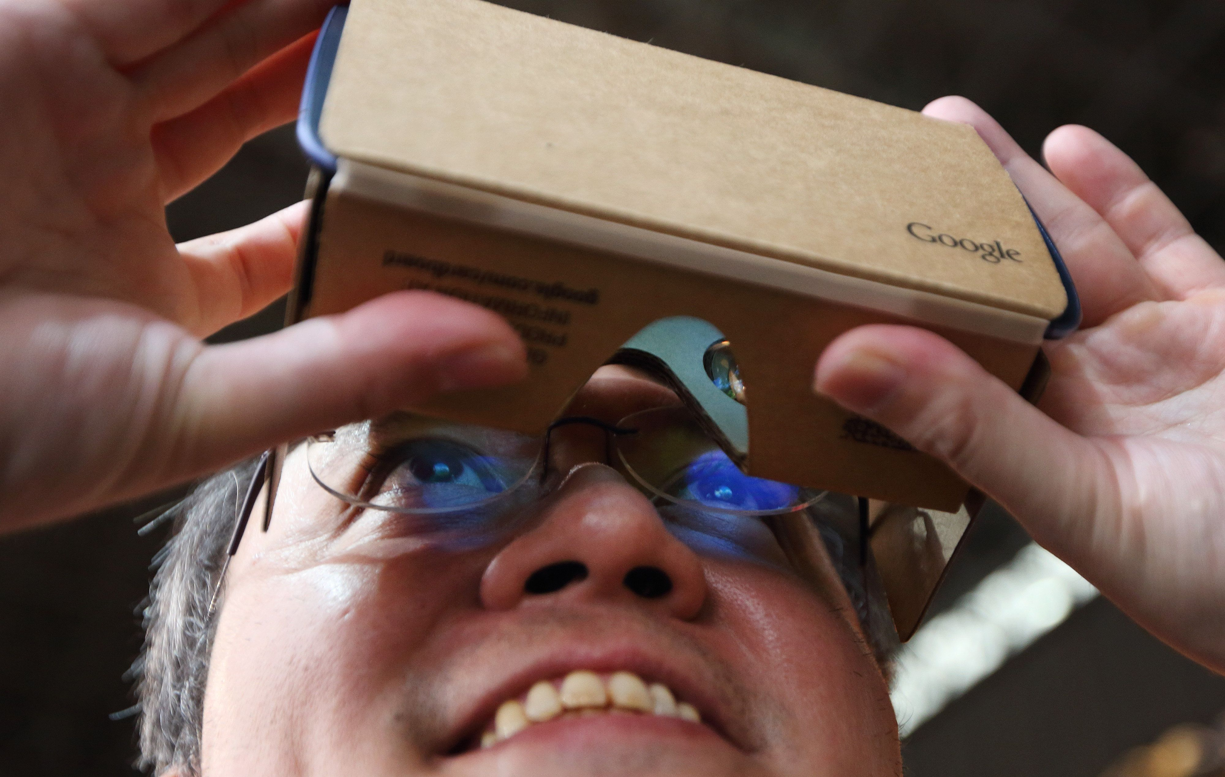 An attendee tries a Google Inc. Cardboard virtual reality headset at the Tokyo Game Show 2015 at Makuhari Messe in Chiba, Japan, on Thursday, Sept. 17, 2015. There will be record attendance at this year's show with 473 vendors, including more than half from abroad, as of Sept. 1, according to organizers. Photographer: Tomohiro Ohsumi/Bloomberg via Getty Images