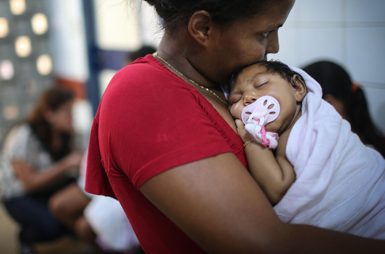 Newborn Ludmilla Hadassa Dias de Vasconcelos, who has microcephaly, is held at Oswald Cruz Hospital on January 26, 2016 in Re