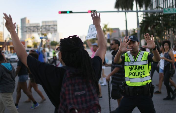 Demonstrators march to protest police abuse in Miami, whose police department is one of those criticized in theACLU rep