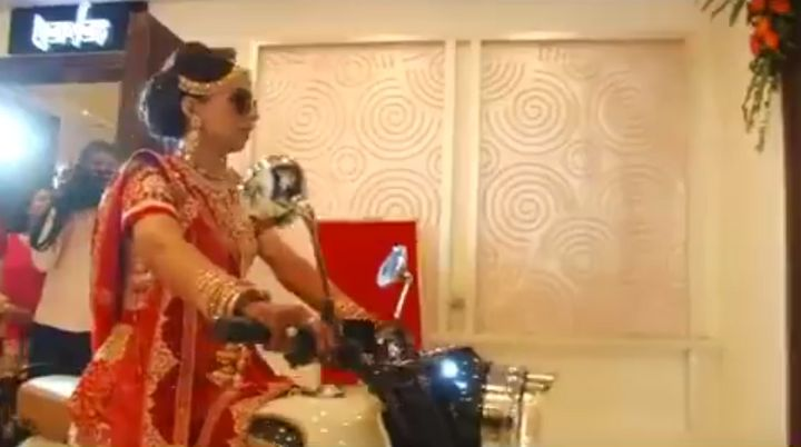 "Ayesha Upadhayay is being hailed as the ""real Bullet Rani"" on social media after arriving at her wedding on a Bullet mot"