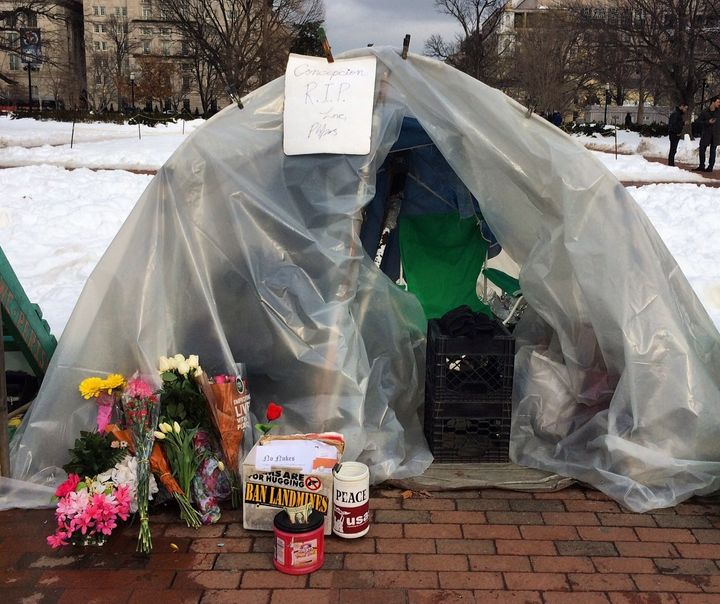People left bouquets of flowers at the vigil on Wednesday in memory of Picciotto.