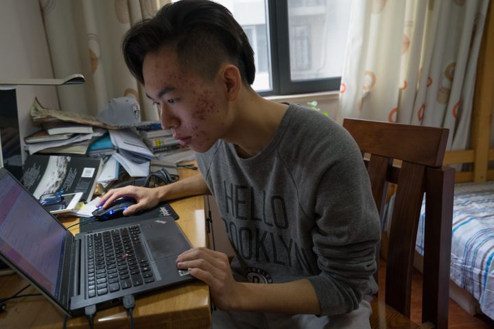 Frank sits inhis room after finishing his last applications to U.S. colleges.