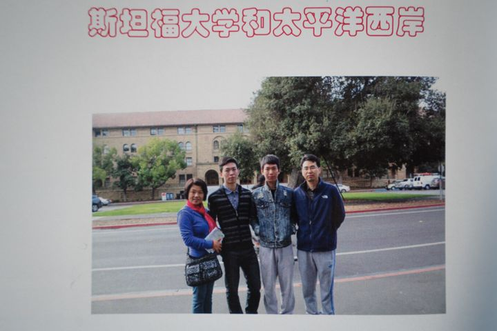 A page from a scrapbook shows the family outside the Stanford political science building.