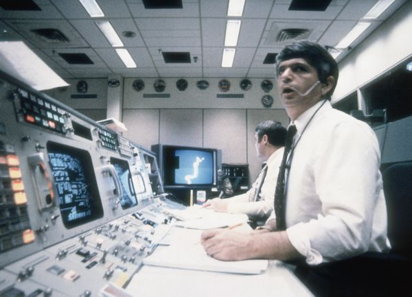 Frederick Gregory, spacecraft communicator at Mission Control in Houston, watches helplessly as the Challenger shuttle explod
