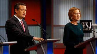 Ted Cruz, left, speaks as Carly Fiorina listens during Republican presidential debate at Milwaukee Theatre, Tuesday, Nov. 10, 2015, in Milwaukee. (AP Photo/Morry Gash)