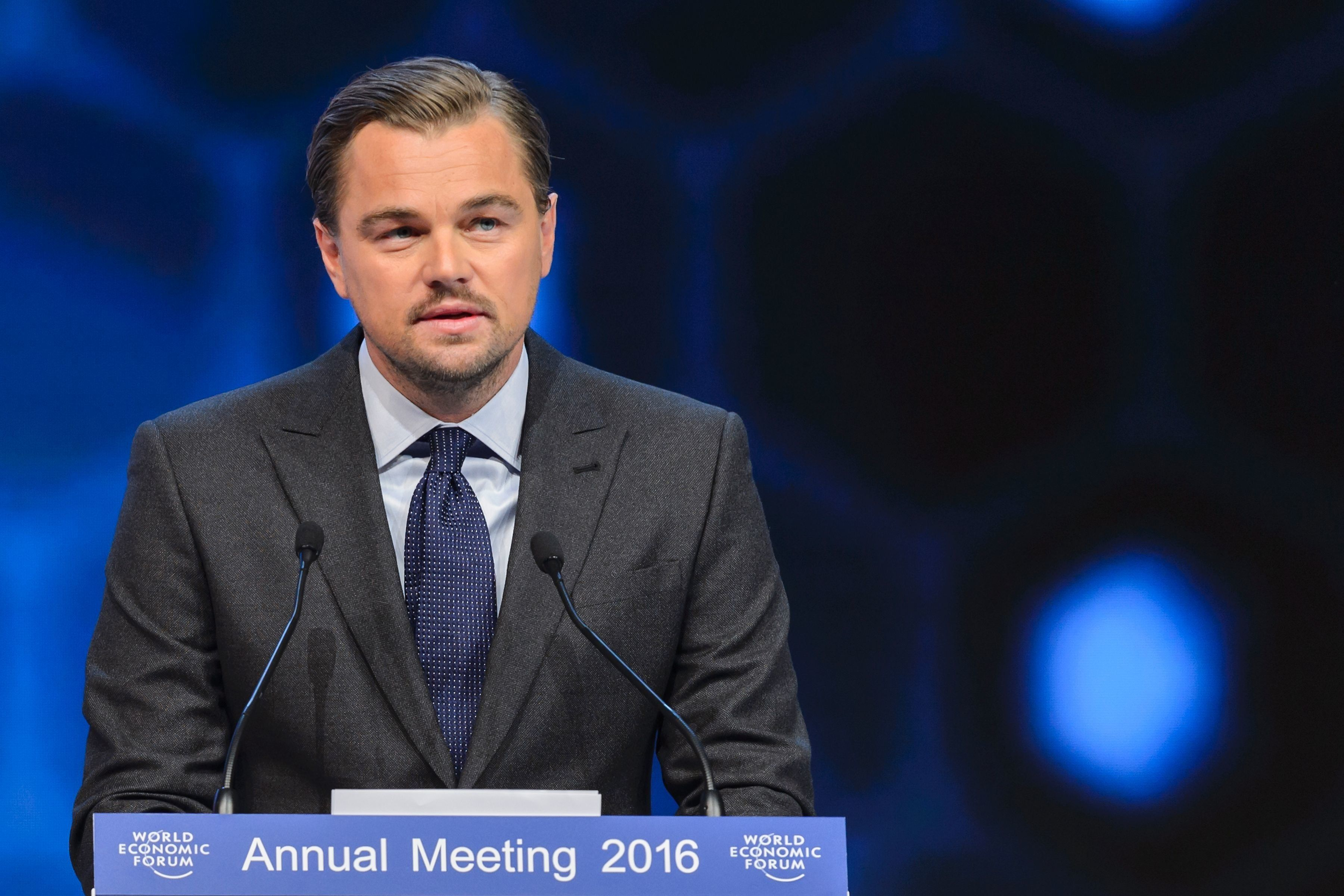 Leonardo DiCaprio delivers a speech after he was awarded during the 22nd Annual Crystal Awards at the opening of the World Ec