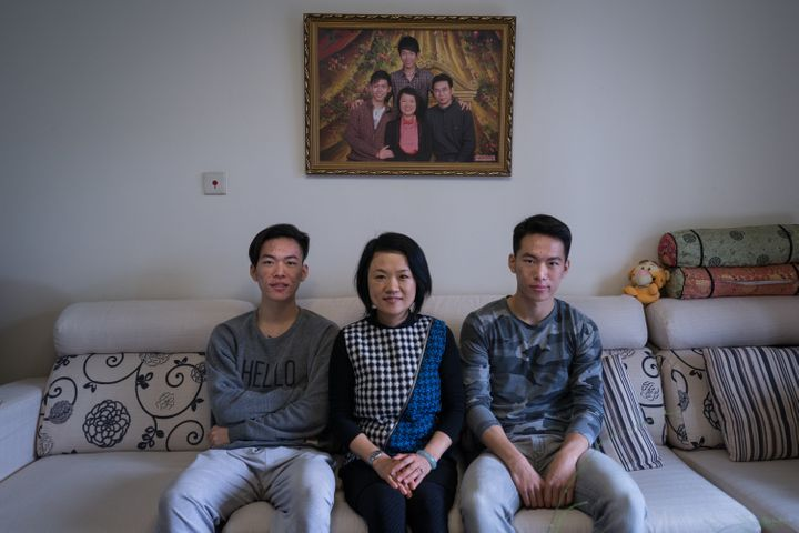 Frank (left) and Richard (right) with their mother Wendy at home in Beijing.