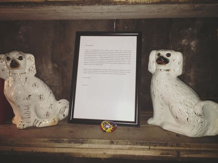 The beloved porcelain dogs, Cederick and Cecil, alongside the perfect apology letter.