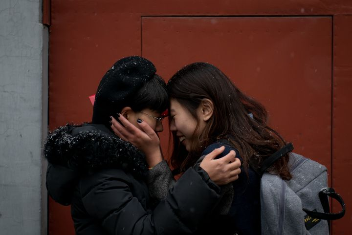 Mayu Yu and Elsie Lau stand outside a marriage registry office in Beijing, where they were refused a marriage license in Febr