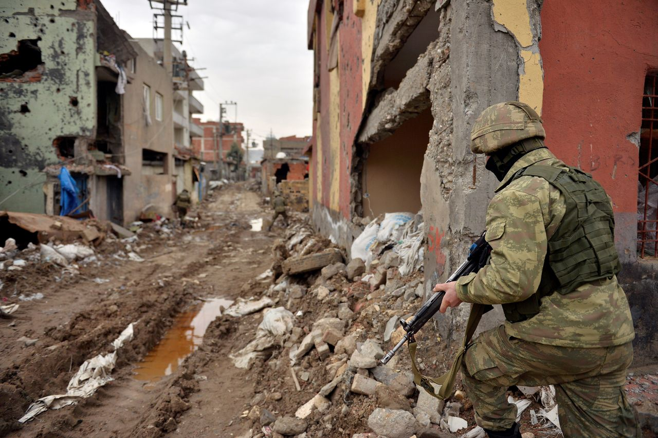 Turkish security forces patrol Cizre District on Saturday. Turkey's battle against Kurdish militants reignited last summer, causing alarm in Europe, where the country is being vetted for European Union membership.