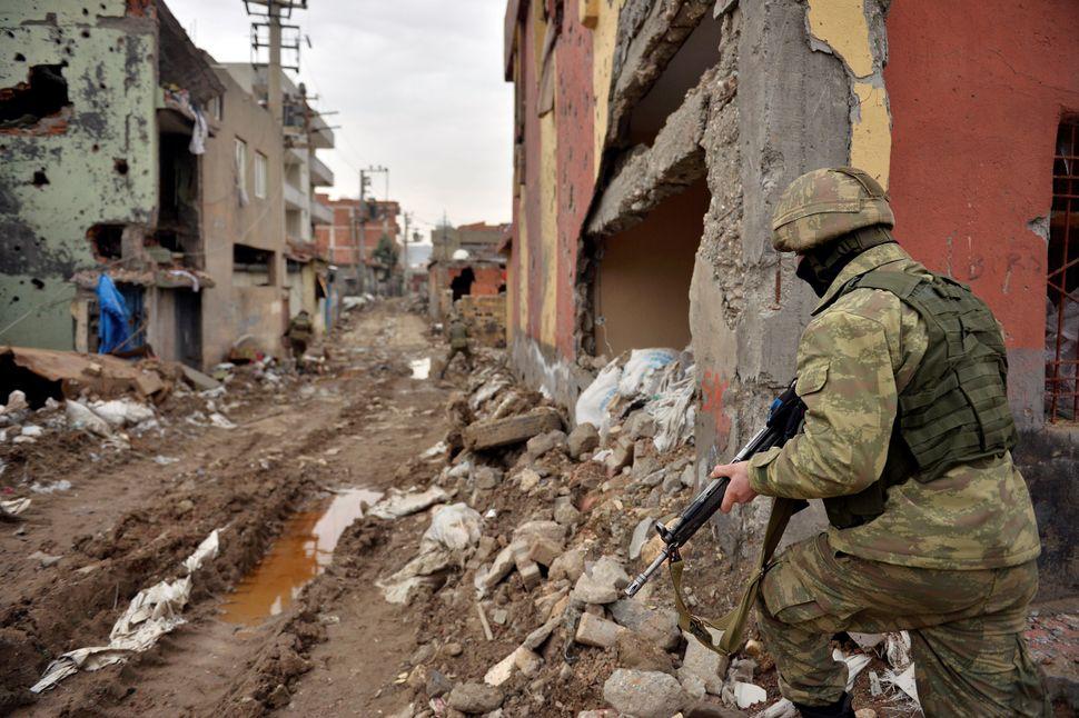 Turkish security forces patrol Cizre District onSaturday. Turkey's battle against Kurdish militants reignited last summ