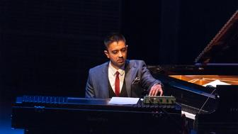 American jazz musician Vijay Iyer on the Fender Rhodes electric piano leads his sextet in a concert in the Carnegie Hall/Joyce and George Wein Foundation's 'The Shape of Jazz series at Carnegie Hall's Zankel Hall, New York, New York, April 27, 2013. Also pictured are, Mark Shim on tenor saxophone, Stephan Crump on upright acoustic bass, Steve Lehman on alto saxophone, Graham Haynes on cornet, and Tyshawn Sorey on drums. (Photo by Jack Vartoogian/Getty Images)
