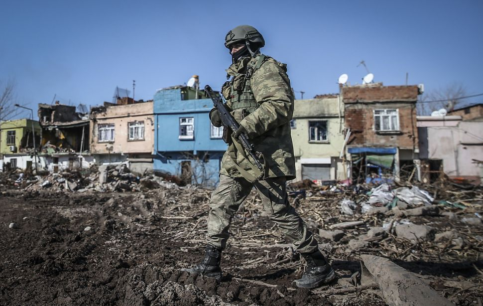 A Turkish soldier patrols Sur, southeast Turkey. The fighting ended two years of ceasefire between the countryand the K