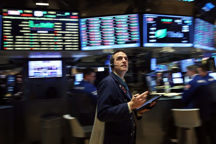 Traders work on the floor of the New York Stock Exchange (NYSE) on January 29, 2016 in New York City.