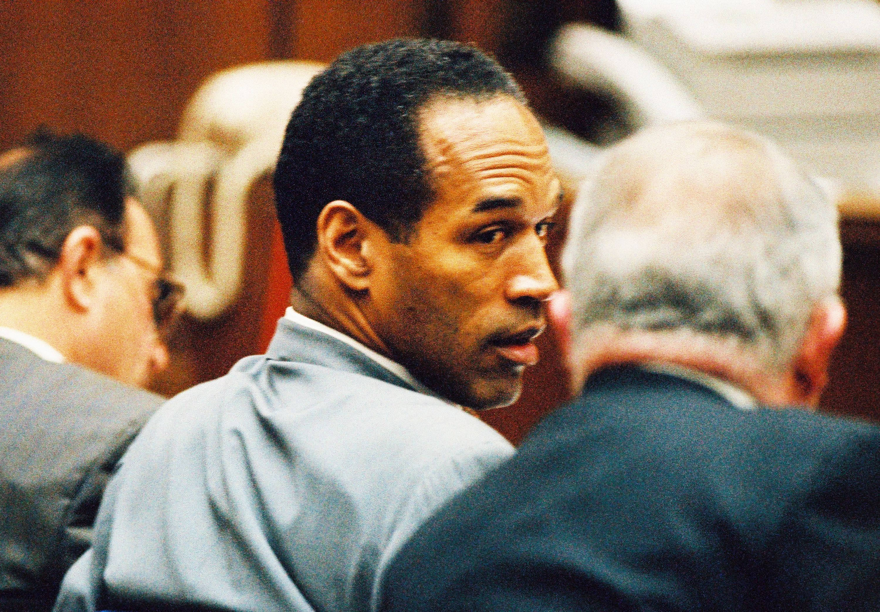 On Jan. 12, 1995, O.J. Simpson confers with his lawyer F. Lee Bailey during a pre-trial hearing.