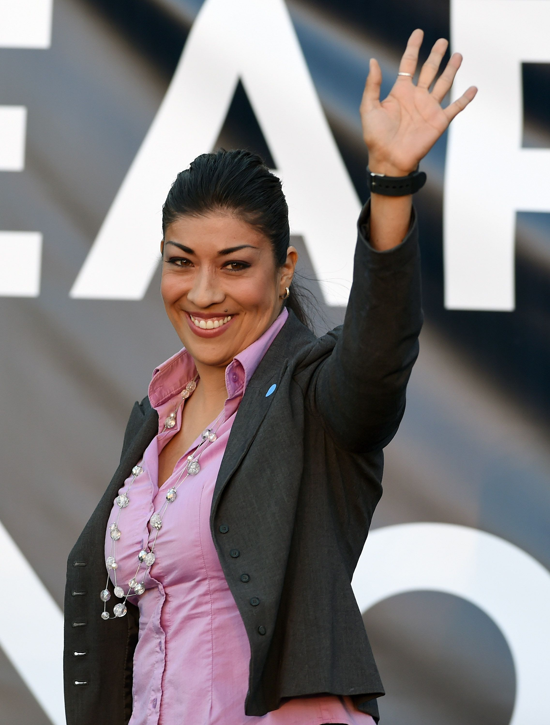 LAS VEGAS, NV - OCTOBER 28:  Democratic candidate for lieutenant governor and current Nevada Assemblywoman Lucy Flores (D-Las Vegas) waves as she is introduced at a get-out-the-vote rally at the Springs Preserve on October 28, 2014 in Las Vegas, Nevada. Former U.S. President Bill Clinton spoke at the event while stumping for Nevada Democrats one week before the November 4th election.  (Photo by Ethan Miller/Getty Images)