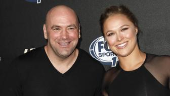 HOLLYWOOD, CA - SEPTEMBER 09:  (L-R) Dana White and Ronda Rousey attend FOX Sports 1's 'The Ultimate Fighter' season premiere party at Lure on September 9, 2014 in Hollywood, California.  (Photo by Tibrina Hobson/WireImage)