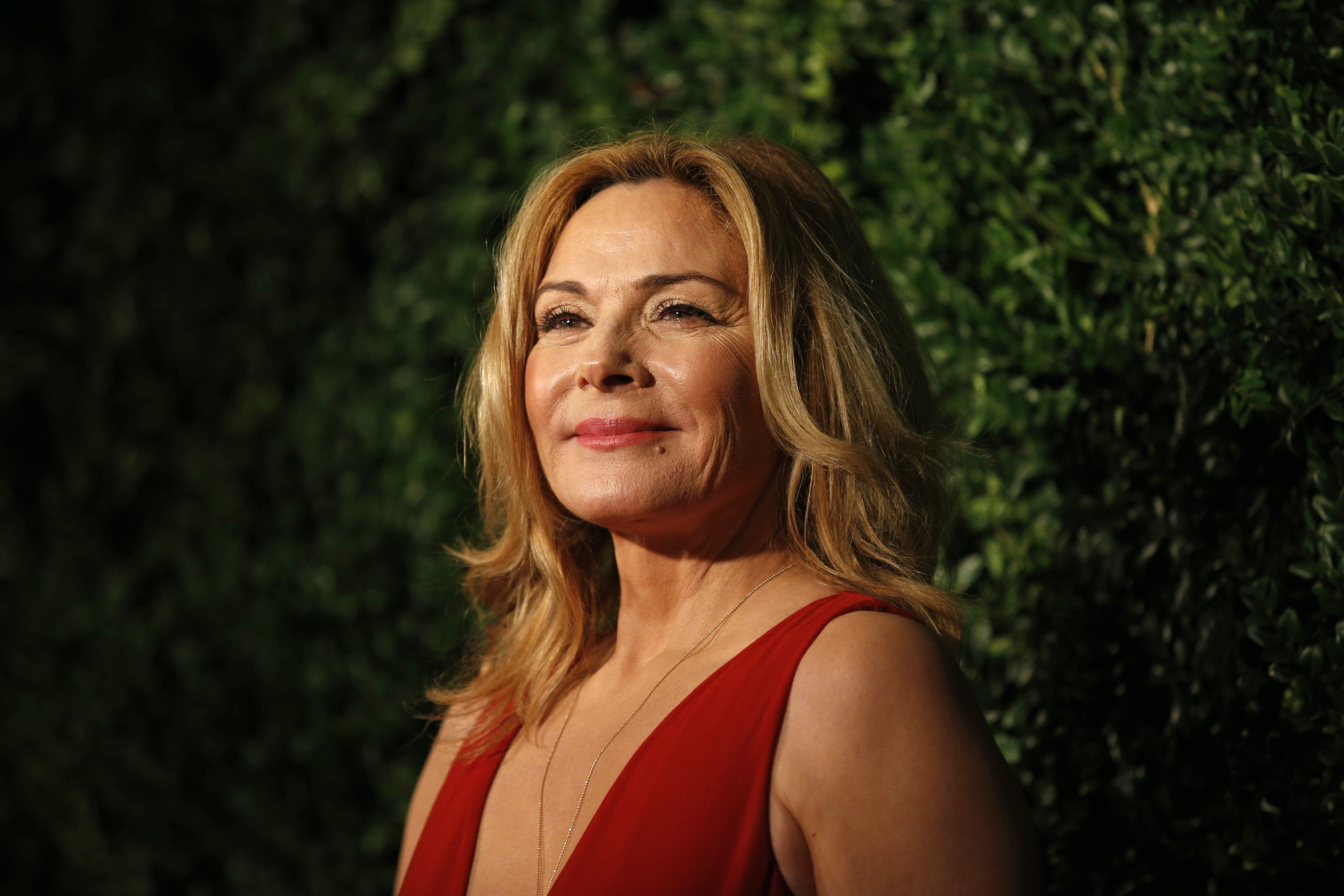 British-Canadian actress Kim Cattrall poses on the red carpet as she attends the 60th London Evening Standard Theatre Awards 2014 in London on November 30, 2014. AFP PHOTO / JUSTIN TALLIS        (Photo credit should read JUSTIN TALLIS/AFP/Getty Images)