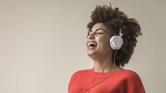 Young black female wearing headphones laughing