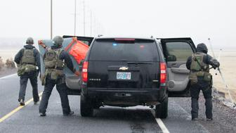 BURNS, OR  - JANUARY 28:  FBI agents removed a road block sign as a large group of law enforcement officials entered a checkpoint on the Malheur National Wildlife Refuge January 28, 2016 near Burns, Oregon. On January 26 eight protestors who have been occupying the refuge were arrested and one, LaVoy Finicum, was killed when the police attempted a traffic stop on U.S. 395 in a desolate area away from the refuge. The protestors first took over the Malheur National Wildlife Refuge on January 2 to protest the sentencing of two local ranchers. (Photo by Matt Mills McKnight/Getty Images)