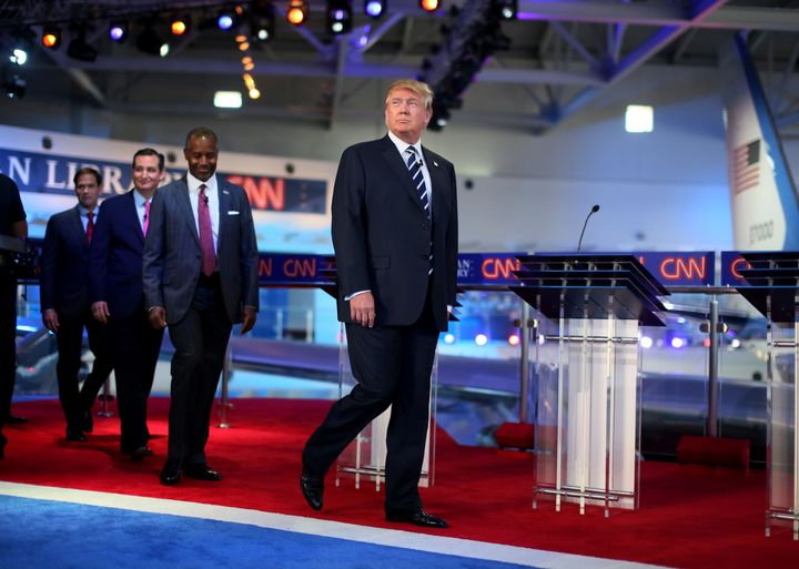 Republican presidential candidate Donald Trump, followed by several rivals,walksonstage for the presidential cand