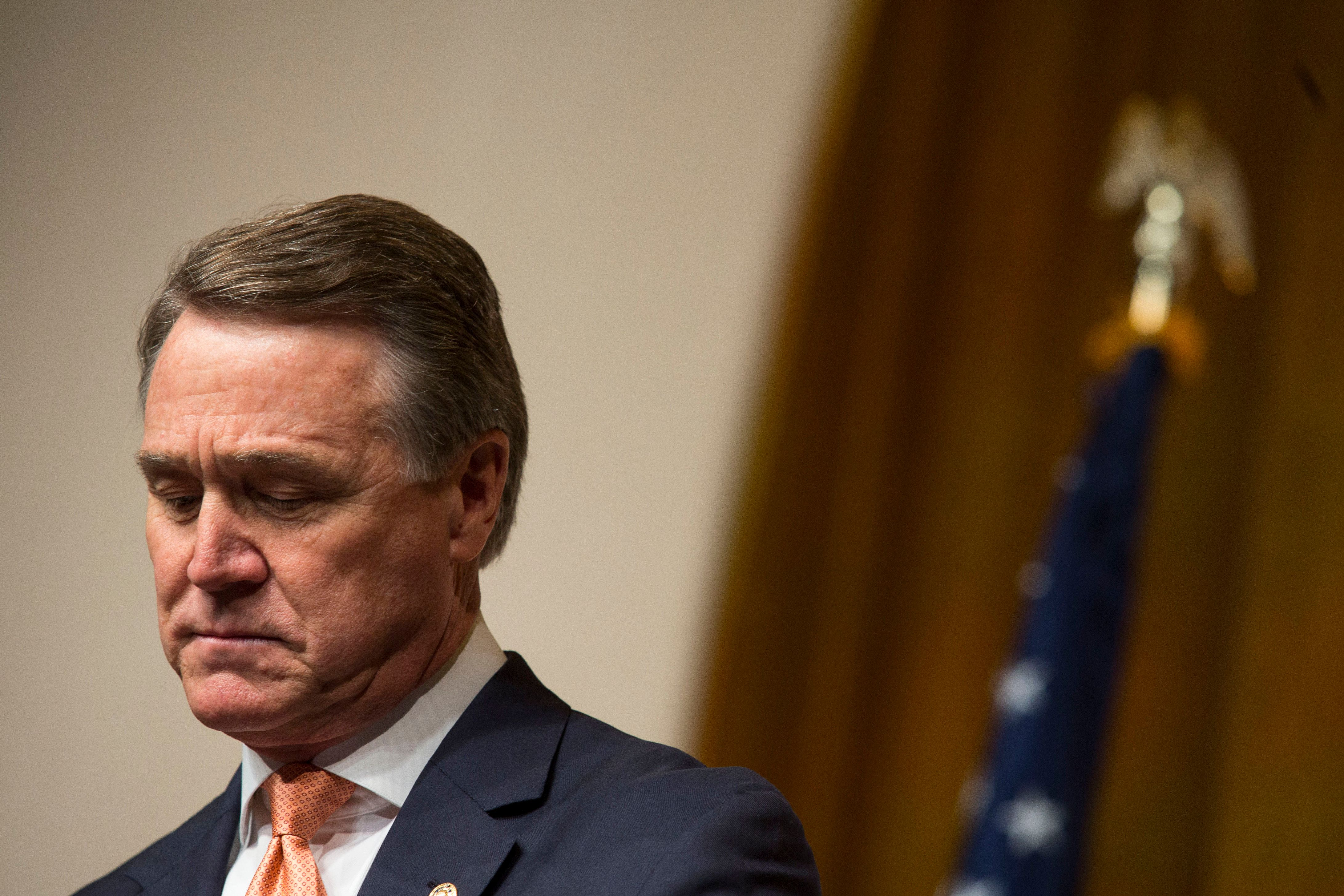 Senator David Perdue, a Republican from Georgia, pauses while speaking during the Faith and Freedom Coalition's 'Road to Majority' conference in Washington, D.C., U.S., on Friday, June 19, 2015. The annual Faith & Freedom Coalition Policy Conference gives top-tier presidential contenders as well as long shots a chance to compete for the large evangelical Christian base in the crowded Republican primary contest. Photographer: Drew Angerer/Bloomberg via Getty Images