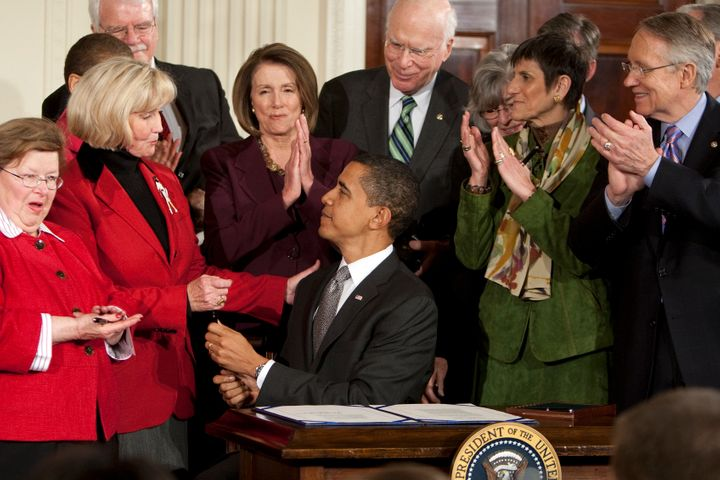 President Barack Obama signs the Lilly Ledbetter Fair Pay Act in 2009, a measure that Supreme Court Justice Ruth Bader Ginsbu