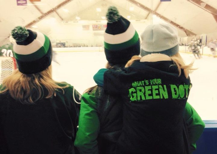 Fans watch the annual Connecticut College Green Dot-themed hockey game.