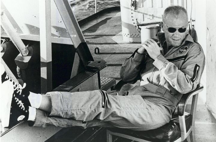 Glenn relaxes on the deck of the USS Noa after his historic space flight.