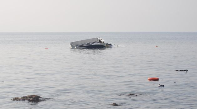 A boat, which was carrying refugees, is seen in the Aegean sea after it sank off close to coast of Ayvacik...