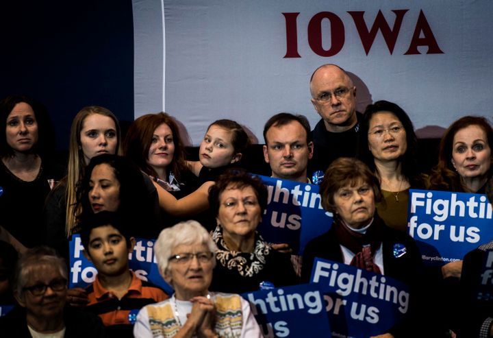 Iowa voters listen to former Secretary of State Hillary Clinton speak at a campaign event in Dubuque, Iowa on Friday, January