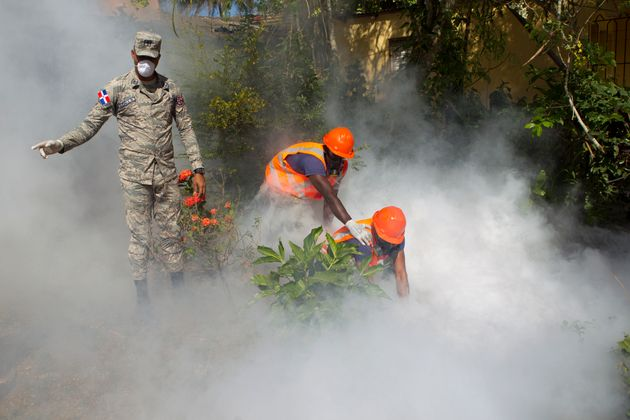 The virus has spread to 23 countries and territories in the Americas. Here the Dominican Air Force fumigates...
