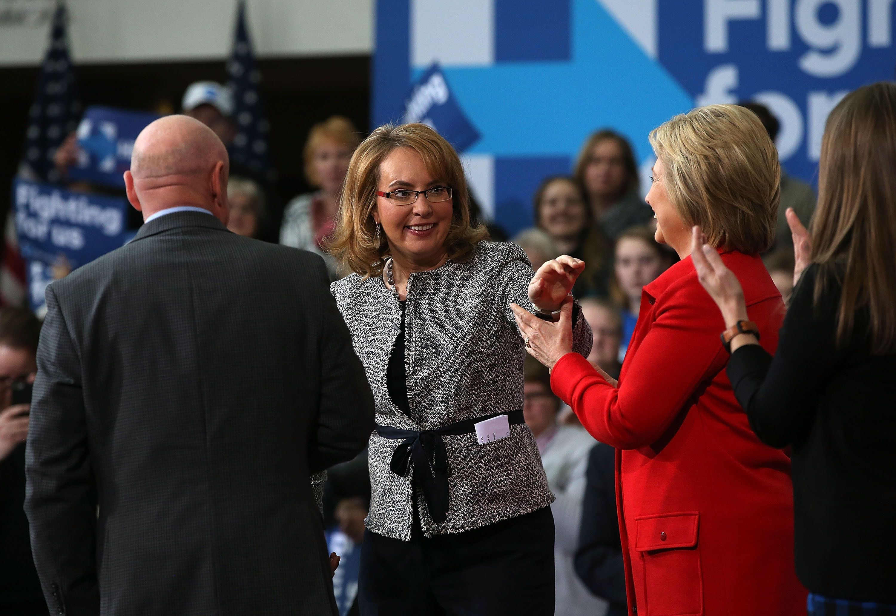 AMES, IA - JANUARY 30:  Former U.S. Sen. Gabrielle Giffords (D-AZ) (C) greets democratic presidential candidate former Secretary of State Hillary Clinton during a 'get out the caucus' event at Iowa State University on January 30, 2016 in Ames, Iowa.  With two days to go before the Iowa caucuses, Hillary Clinton is campaigning throughout Iowa.  (Photo by Justin Sullivan/Getty Images)