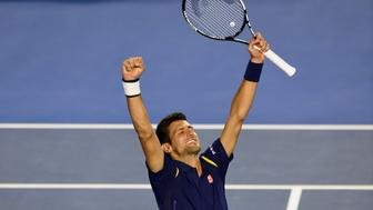 Novak Djokovic of Serbia celebrates his victory over Andy Murray of Britain in their men's singles final match on day 14 of the 2016 Australian Open tennis tournament in Melbourne on January 31, 2016.     AFP PHOTO / GREG WOOD -- IMAGE RESTRICTED TO EDITORIAL USE - STRICTLY NO COMMERCIAL USE / AFP / GREG WOOD        (Photo credit should read GREG WOOD/AFP/Getty Images)