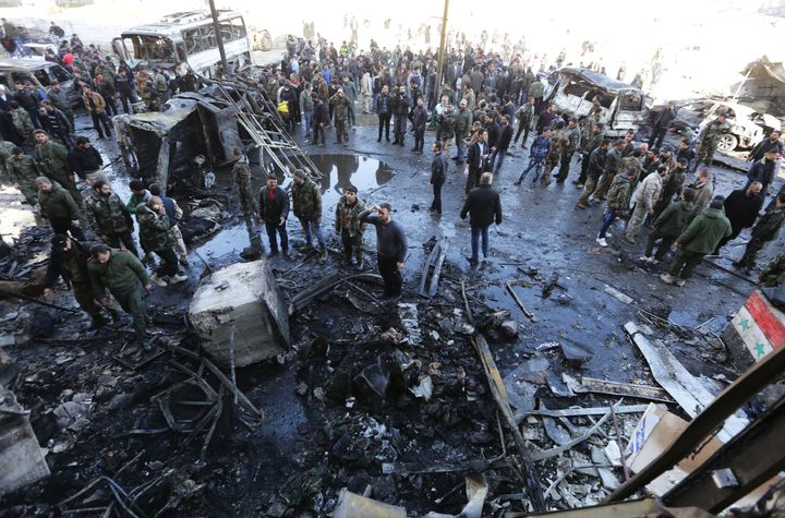 A car bomb and two suicide bombers killed dozens in the Sayeda Zeinab district of Damascus on Sunday.