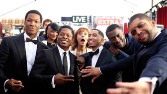 LOS ANGELES, CA - JANUARY 30:  Actress Susan Sarandon (C) photobombs Actors (L-R) Corey Hawkins, Jason Mitchell, Neil Brown Jr., Aldis Hodge and O'Shea Jackson Jr. attend The 22nd Annual Screen Actors Guild Awards at The Shrine Auditorium on January 30, 2016 in Los Angeles, California. 25650_013  (Photo by Dimitrios Kambouris/Getty Images for Turner)