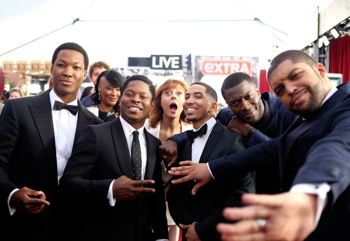 """Susan Sarandon photobombs the cast of """"Straight Outta Compton"""" during the SAG Awards red carpet on Jan. 30."""