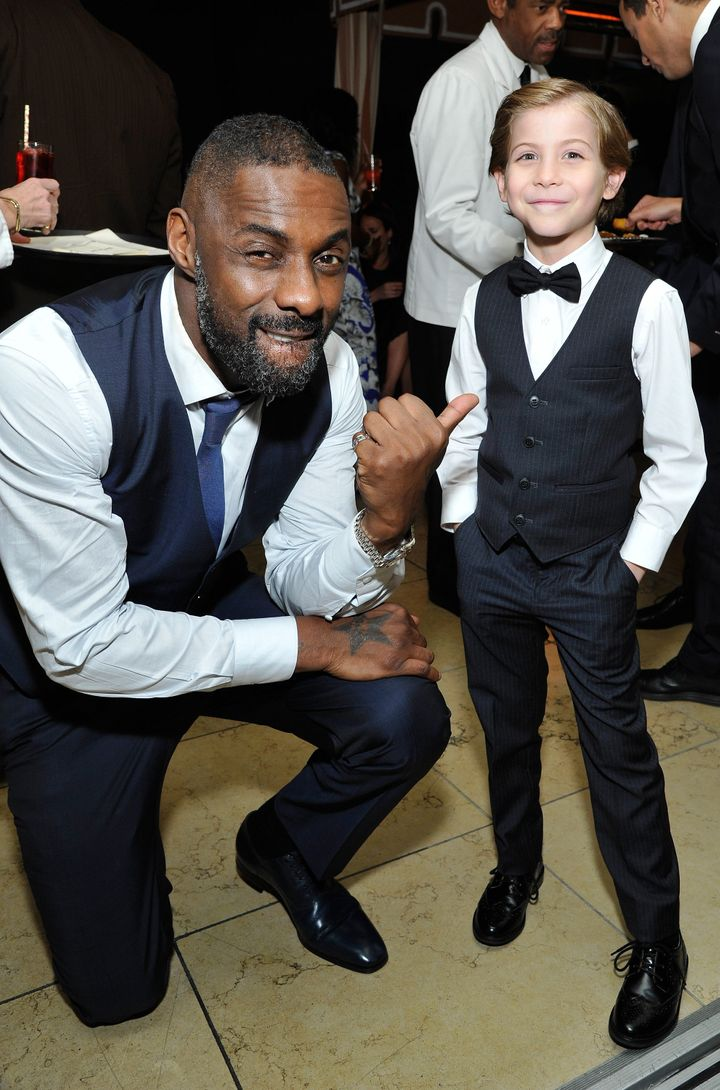 Idris Elba strikesa pose with Jacob Tremblay at the Weinstein-Netflix after-party.