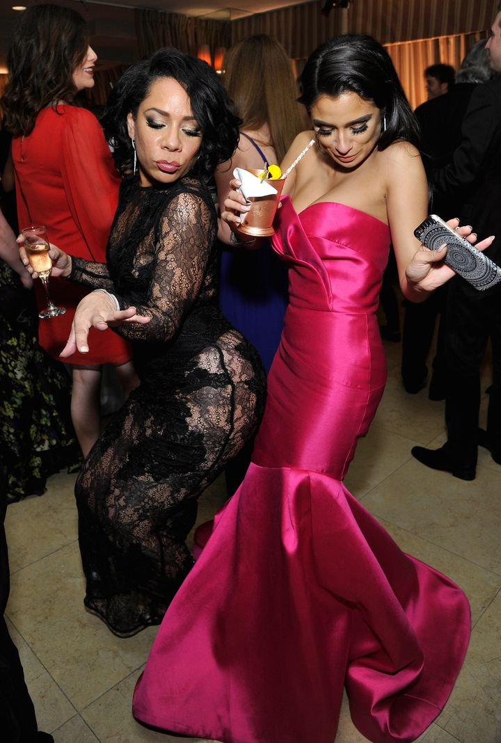Selenis Leyva and Diane Guerrero celebrating on the dance floor at the Weinstein-Netflix after-party.