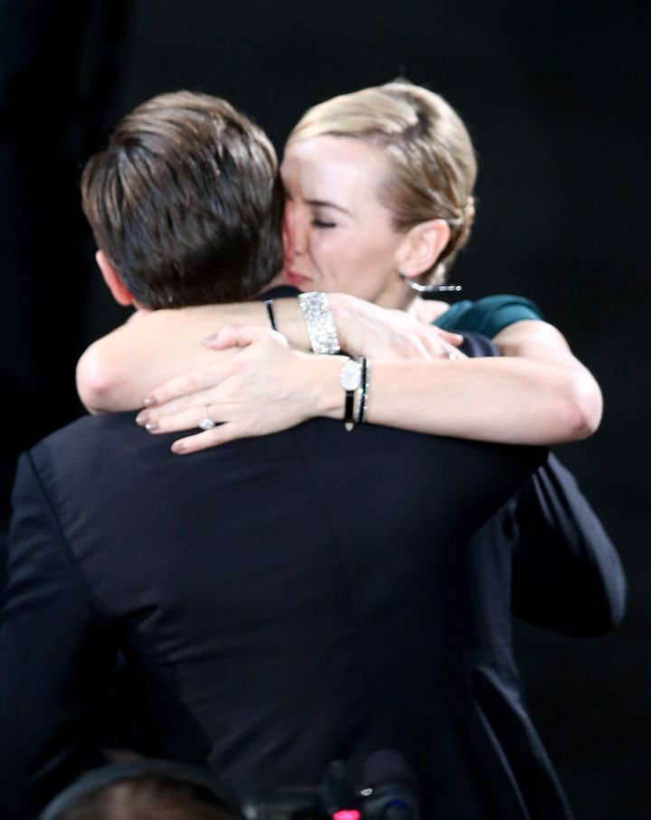"Kate Winslet congratulates Leonardo DiCaprio after he wins his Best Actor award for his role in ""The Revenant."""