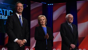 Democratic presidential candidate, former Maryland governor Martin O'Malley (L), former Secretary of State Hillary Clinton (C) and Vermont Senator Bernie Sanders (R) arrive on stage for the NBC News -YouTube Democratic Candidates Debate on January 17, 2016 at the Gaillard Center in Charleston, South Carolina. / AFP / TIMOTHY A. CLARY        (Photo credit should read TIMOTHY A. CLARY/AFP/Getty Images)