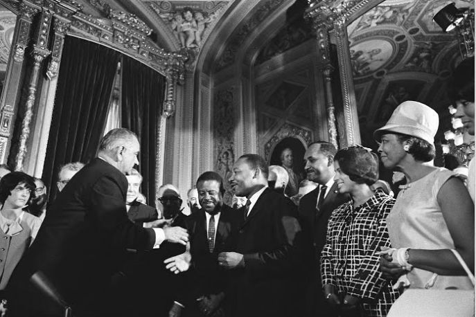 President Lyndon B. Johnson and Dr. Martin Luther King shake hands in the President's Room of the U.S. Capitolon Aug. 6