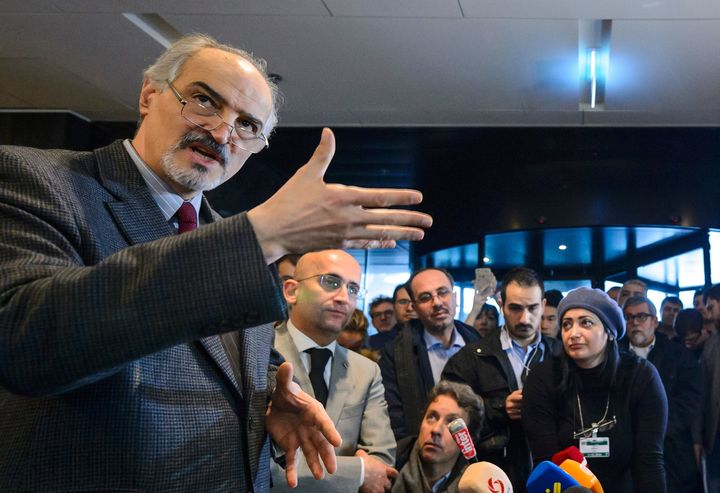 Syrian ambassador to the UN and head of the government delegation Bashar al-Jaafari gestures as he holds a press conference d