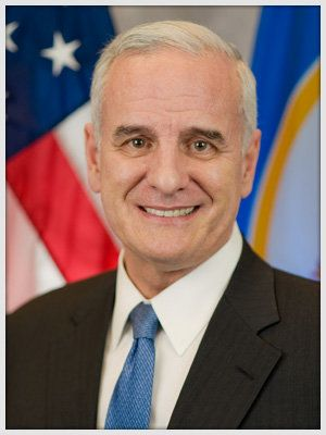 Minnesota Gov. Mark Dayton is spending the night at a hospital after fainting during a political event on Sunday.