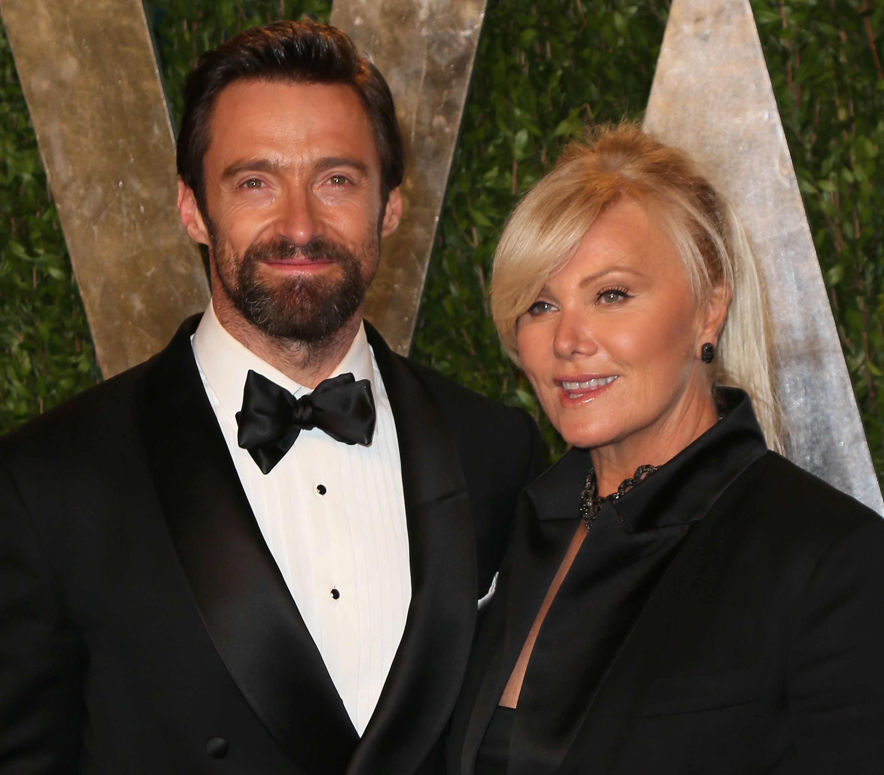 WEST HOLLYWOOD, CA - FEBRUARY 24:  Actor Hugh Jackman (L) and wife Deborra-Lee Furness attend the 2013 Vanity Fair Oscar Party at the Sunset Tower Hotel on February 24, 2013 in West Hollywood, California.  (Photo by David Livingston/Getty Images)