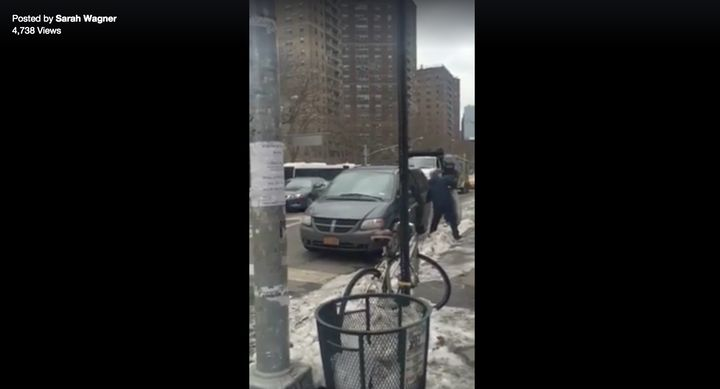 The man is seen putting the pigeons in the back of a nearby minivan.