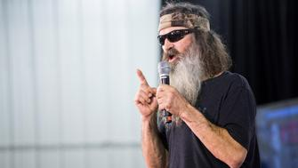 WASHINGTON, USA - JANUARY 31: Star of Duck Dynasty, Phil Robertson, speaks in support of Republican Presidential Candidate Ted Cruz during a campaign rally in Iowa City, Iowa, USA on January 31, 2016. Both Democratic and Republican candidates are campaigning in Iowa this weekend before the Iowa Caucus on Monday. (Photo by Samuel Corum/Anadolu Agency/Getty Images)