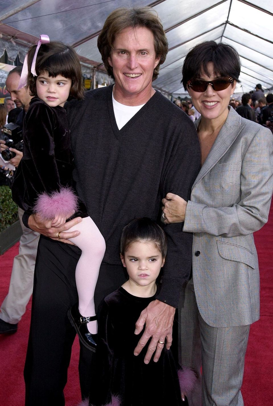 HOLLYWOOD, :  Former US gold medal decathlete Bruce Jenner (C), his wife Kris (R) and children Kylie (L) and Kendall (BELOW)